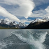 The wake from the boat has a symmetry with the clouds in the sky on Maligne Lake, in Jasper National Park, Alberta, Canada.